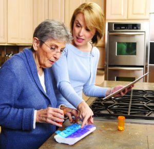 Women in kitchen with pills iStock_000015649040Medium