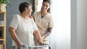 One of our caregivers providing in-home physical therapy for an elderly patients
